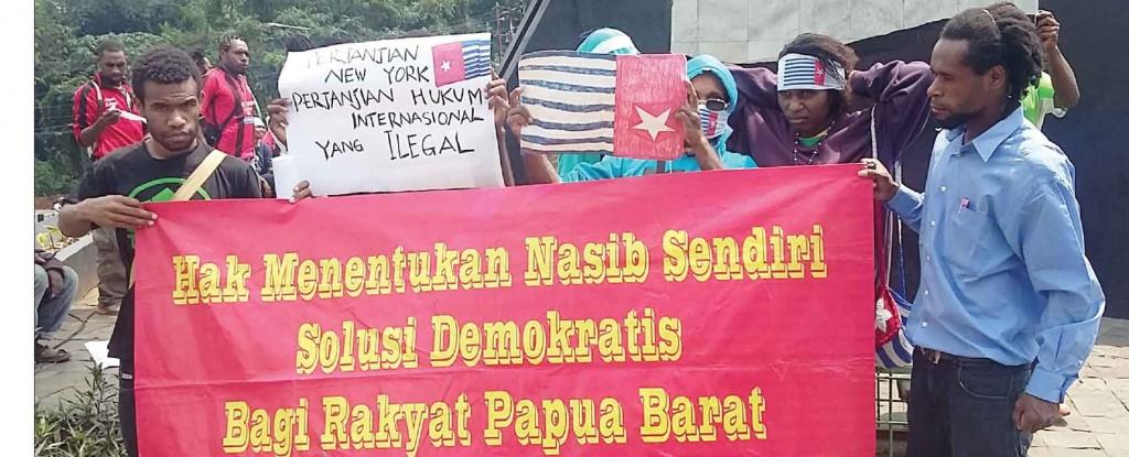 PROTES: Aliansi Mahasiswa Papua (AMP) Kota Bogor mengecam tindakan kekerasan dan diskriminasi yang terjadi di Papua.