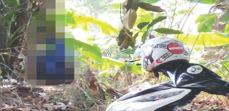 TERGANTUNG: Pria bernama Agus Maulana ditemukan meninggal tergantung di pohon nangka kawasan pemakaman Kebun Karet, Kelurahan Cipayung Jaya, Kecamatan Cipayung, Kamis (13/9/18). Irwan/Radar Depok