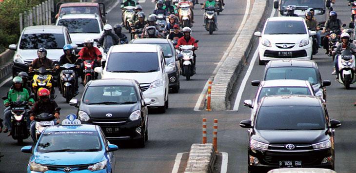 Sejumlah kendaraan saat melintas di kawasan Jalan Margonda Raya.