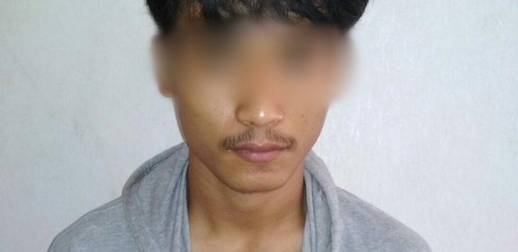Pemuda berinsial TBS aliasT, (20) warga Desa Karangwangun saat di amankan pihak kepolisian Foto: Kirno