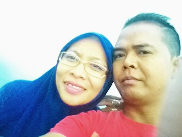 Almarhumah Ruhyatun bersama suaminya Didin (Fb)