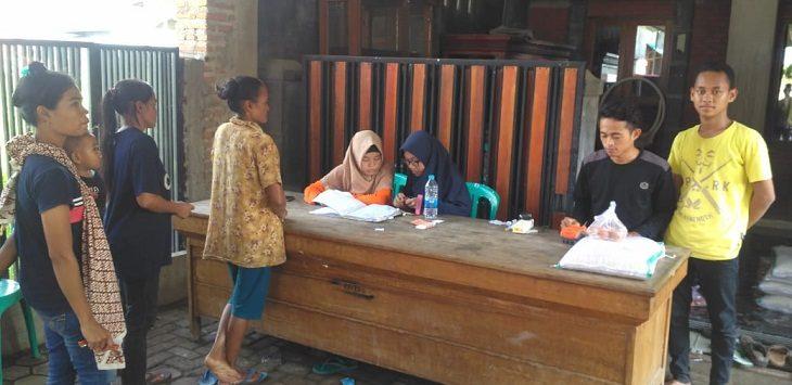 Keluarga Penerima Manfaat BPNT antre di E-Warung./Foto: Yon