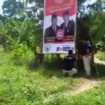 Tiga pria berbadan tegap mencopot baliho Prabowo-Sandi di kawasan Sentul City Kabupaten Bogor (ist)