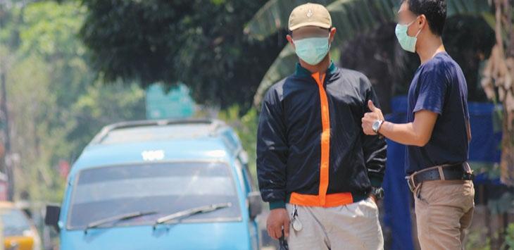 Ilustrasi pengguna masker.