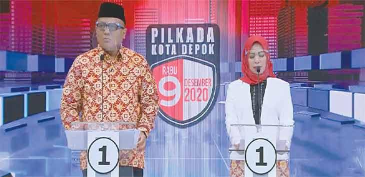 Pradi Supriatna dan Afifah Alia pasangan nomor urut 1 calon Walikota/Wakil Kota Depok saat menjawab pertanyaan debat, Senin (30/11).